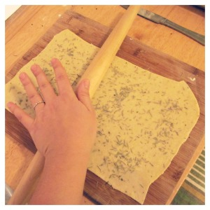 rolling out dough for crackers